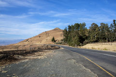 Top of Mountain Pass with Outcrop of Trees on Right Royalty Free Stock Images