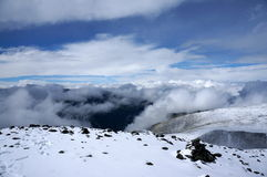 On the top of Mountain Pass. Over the clouds on the top of the Kara Tyurek Mountain Pass in summer Stock Image