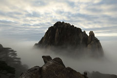The top of the mountain from the sea of clouds above, Huangshan in China Royalty Free Stock Images