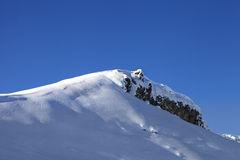 Top of mountains with snow cornice after snowfall Stock Photo