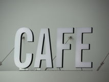 Top mounted White Cafe Sign with Wires Stock Images