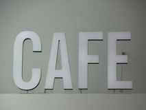 Top mounted White Cafe Sign with Wires Royalty Free Stock Photo