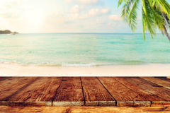 Free Top Of Wood Table On Blurred Sea With Coconut Tree Background Stock Photo - 88748130