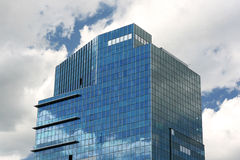 Top of the Office Building. Top floors of the modern office building over cloudy sky Royalty Free Stock Image