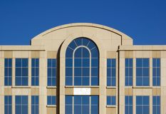 Top of Office Building and Cloudless Sky - Horizontal. Top of office building and cloudless blue sky reflected in its windows - horizontal stock images