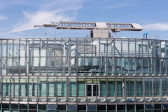 Top of an office building with crane for window washers Royalty Free Stock Photos