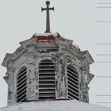 Top of old church steeple against gray winter sky Royalty Free Stock Photos