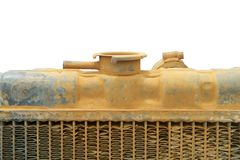 Top of old tractor radiator. Top of old, yellow tractor radiator, isolated Stock Photo