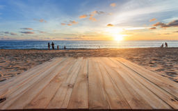 Top of old wooden table at sunset beach in Thailand Stock Photos