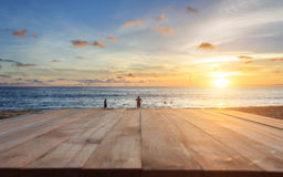 Top of old wooden table at sunset beach in Thailand Royalty Free Stock Image