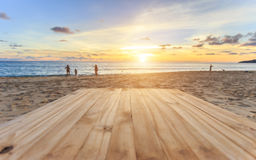 Top of old wooden table at sunset beach in Thailand Stock Images