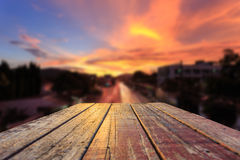 Top of old wooden table and sunset blur background. Close up top of old wooden table and sunset blur background Royalty Free Stock Image
