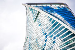 The top of one building of business complex Moscow City in cloud Stock Image