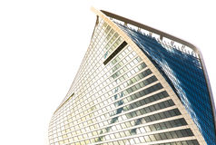The top of one building of business complex Moscow City in cloud. S. A lot of glass and concrete in modern architecture. Toned Royalty Free Stock Image