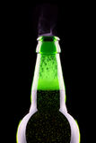 Top of open wet beer bottle. Isolated on black Royalty Free Stock Images