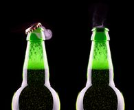 Top of open wet beer bottle. Isolated on black Royalty Free Stock Photo