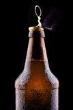 Top of open wet beer bottle. Isolated on black Royalty Free Stock Photography