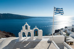 Top of orthodox church with greece flag in Santorini Royalty Free Stock Image