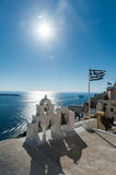 Top of orthodox church with greece flag - Santorini Stock Images