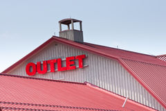 Top of outlet mall. The top of an outlet mall, with the word 'Outlet' the focus of the image Stock Images