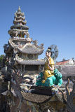 The top of the pagoda Linh Phuoc and sculpture of a seated Buddha. Da Lat, Vietnam Stock Images