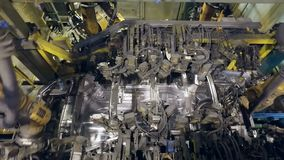 Top panorama of making car body by robots on a car factory stock video