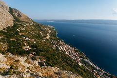 Top panoramic view from the fortress Stari Grad near Omis on the town of Nemira in Croatia Royalty Free Stock Photos