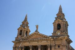Top part of facade of St. Publius` Church in Floriana Malta royalty free stock photography