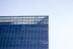 Top part of a glass window wall of an office building. stock images