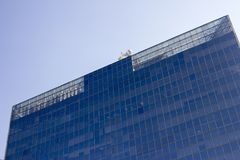 Top part of a glass window wall of an office building. royalty free stock image