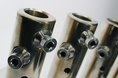 Top part of large diameter electric cable connection tubes with allen key screws, made of stainless steel Stock Images