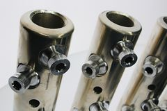 Top part of large diameter electric cable connection tubes with allen key screws, made of stainless steel stock photo