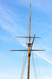 Top part of the Pride Memorial mast against blue winter sky. T. He Pride Memorial is installed on the Rash Field of Baltimore Inner Harbor Royalty Free Stock Photo