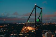 Top part of skyscraper against night city. Tallinn, Estonia Royalty Free Stock Photography
