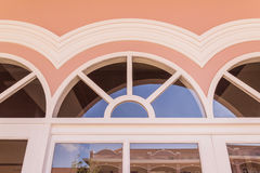 Top part of window on top of door of Chino-Portuguese architectural style Royalty Free Stock Image