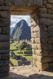 The top of the peak of Huayna Picchu, in the frame of the gate stock image
