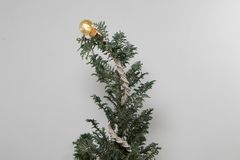 Christmas tree knit with macrame and light bulb white background royalty free stock images