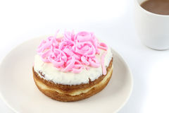Top pink donut. Pink donut on dish with white background Royalty Free Stock Photography