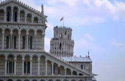 The top of Pisa tower behind the Cathedral Stock Photography