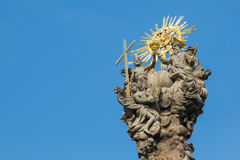 Top of the plague column in Kremnica, Slovakia. With sculptures of jesus christ and god among others Stock Photos