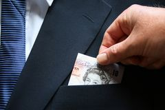 Top Pocket. Business suit top pocket with a British ten pound note stock images