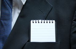 Top Pocket. Business suit top pocket with a lined notepad royalty free stock image