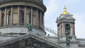 The top point, people climb a ladder, the dome of Saint Isaac`s Cathedral in Saint-Petersburg, Russia. Full HD stock video footage