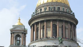 The top point, tourists walking under the dome of Saint Isaac`s Cathedral in Saint-Petersburg, Russia. Full HD stock footage