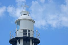 TOP OF PORT SHEPSTONE LIGHTHOUSE. Close view of a the top of a black and white lighthouse against a blue sky Royalty Free Stock Photo