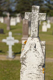 The top portion of a very old tombstone. Stock Photography