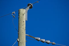 Top of power line pole Stock Images