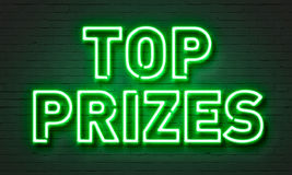 Top prizes neon sign on brick wall background. Stock Photo