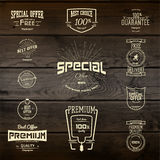 Top quality badges logos and labels for any use. Company corporate logo element design. On wooden background texture Royalty Free Stock Photography
