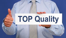 TOP Quality - Manager holding sign with text. Thumb up royalty free stock images